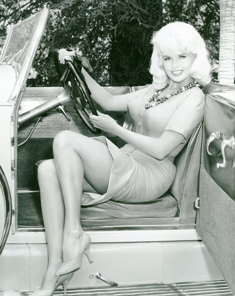 Jayne Mansfield posing seductively