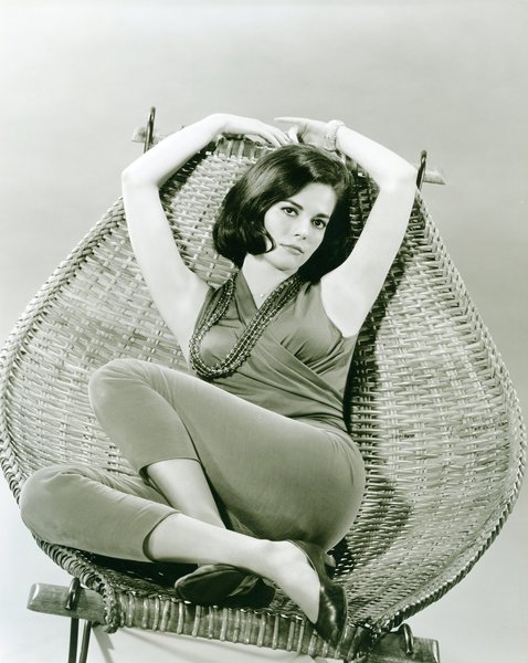 Natalie Wood on a wicker chair