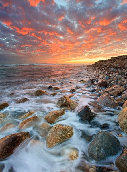 """Matunuck Sunset II"" Vertical rocky beach seascape sunset photograph, taken at Matunuck Beach in South Kingstown, Rhode Island."