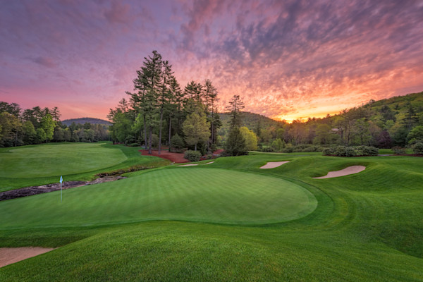 The view across the 9th green at dawn at Wade Hampton Golf Club, in Cashiers, North Carolina