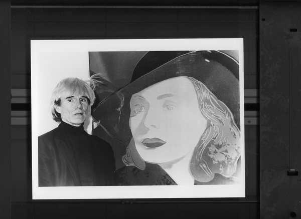 Original Vintage Press Print Andy Warhol posing by a painting artist famous