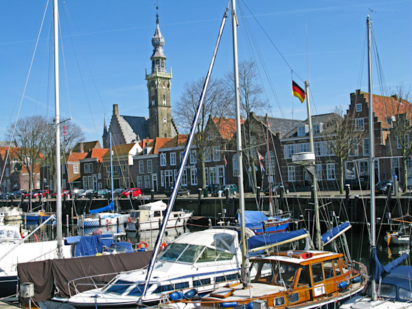 Boats , homes, and Town Hall Tower-- Veere