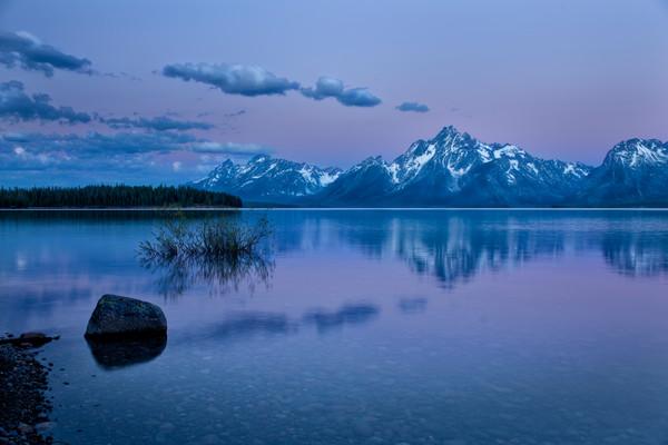 Grand Teton with Jackson Lake at sunrise.