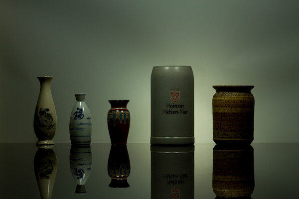 A Fine Art Photograph of Mugs and Vases Reflections on Black Plexi by Michael Pucciarelli