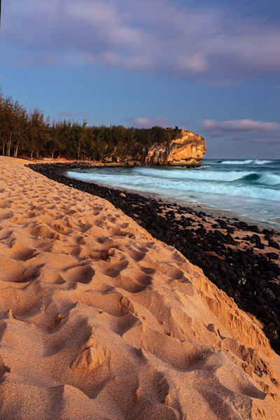 Shipwrecks beach on Kauai at sunset