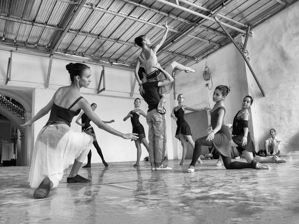 Purchase a photograph of graceful ballerinas at practice for the National Dance Company of Cuba.