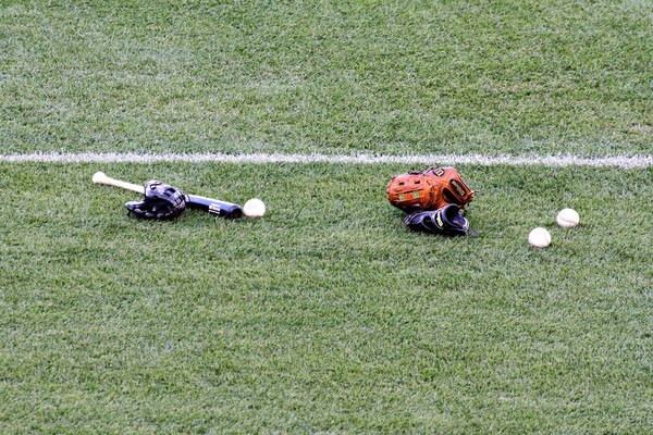Purchase this photograph of baseball equipment on the field waiting for the game to begin.