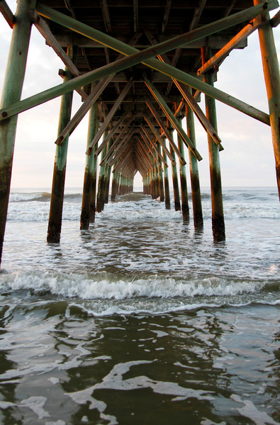 Purchase this photograph Under the Pier in the Early Morning Light.
