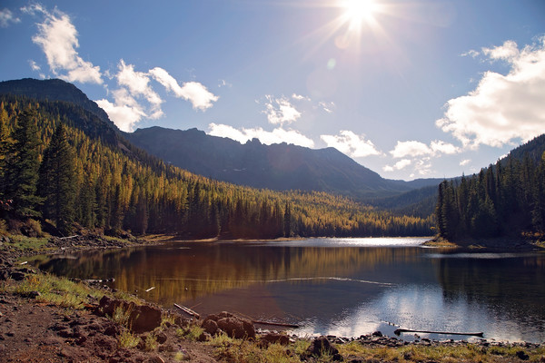 Strawberry Lake in autumn with tamaracks within Strawberry Mountain Wilderness