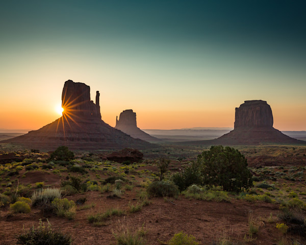 Monument valley sunburst over mittens-full shot