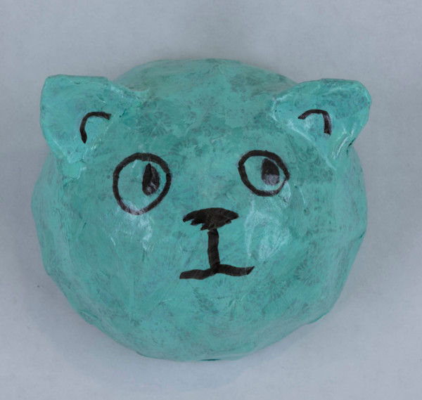 Buy a turquoise paper mache cat face for a fun wall in your home.