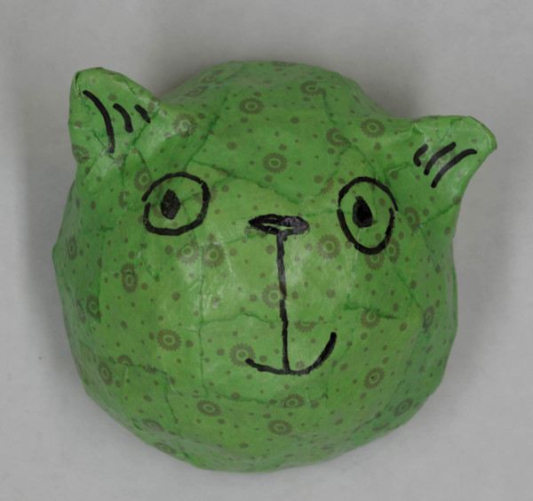 Buy a green paper mache cat face for a fun wall in your home.