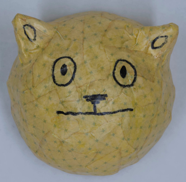 Buy a paper mache nervous cat face for a fun wall in your home.