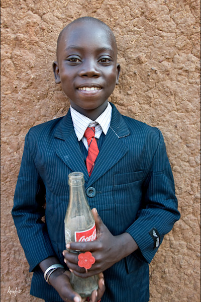 Boy in Armani suite holding Coca Cola bottle, photograph art print