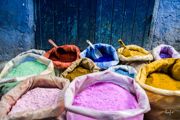 Bags of pigment dyes by blue door and wall  in a fine art photograph print