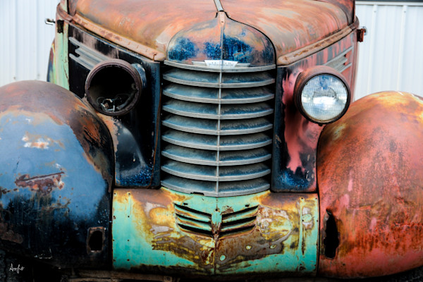 Rustic old Oldsmobile with missing light from the front