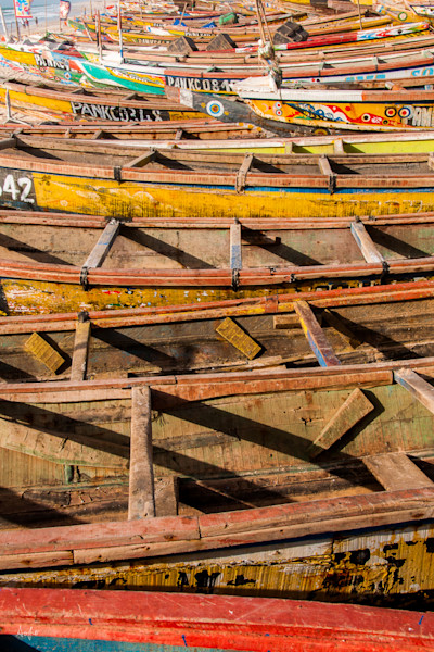 photograph of Traditional colorful fishing boats lining the coast of Nouakchott, fine art