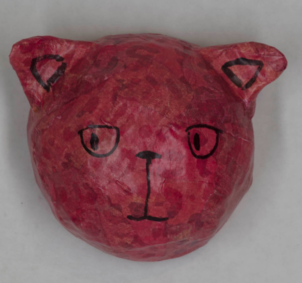 Buy a red paper mache cat face for a fun wall in your home.