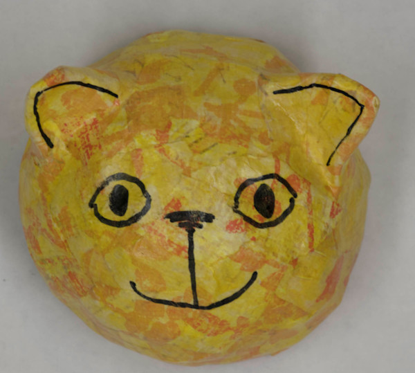Buy a fun paper mache cat face for your wall.