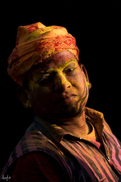 Fine art photograph print of man with head scarf covered in Holi colors