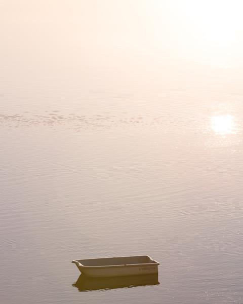 lone boat at dawn