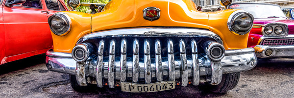Panorama of old yellow Buick from the front with shiny chrome grille, art photograph