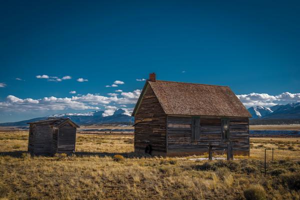 Photo of Old Cedar homestead House with Outhouse on Farm