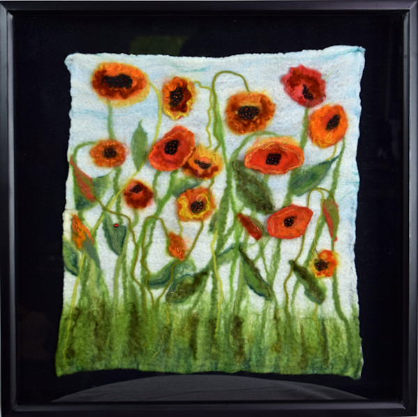 Felted field of poppies mounted in a shadowbox