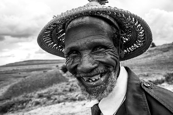 Lesotho man in traditional hat with big smile and bad teeth, in photograph art print