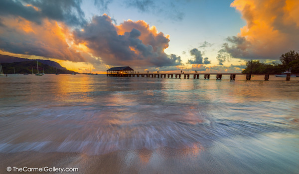 photo of sunset over Hanalei Pier