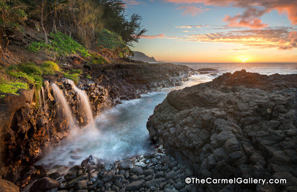 Queen's Bath double Waterfall in Kauai at sunset