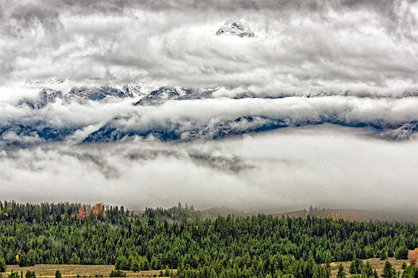 Fog Layers over the Grand Tetons a digital photo by Fred Neveu.