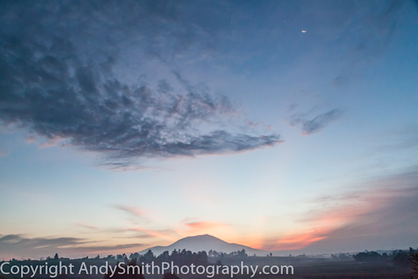 fine art photograph of sunrise with Crescent Moon and Venus