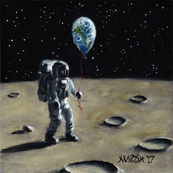 Astronaut on the moon holding balloon of Earth art