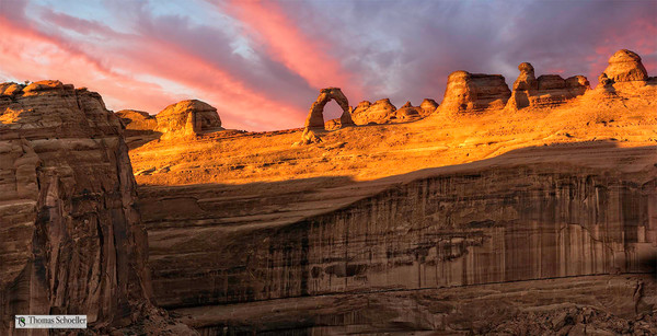 Sunset over the Delicate Arch in Arches National Park Utah. Bring home fond memories with this fine art print