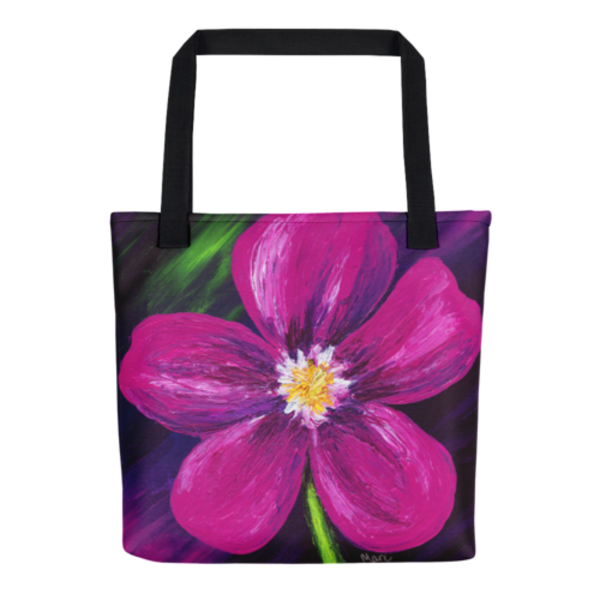 Colorful tote bags with original artwork by Mary Anne Hjelmfelt printed on them.