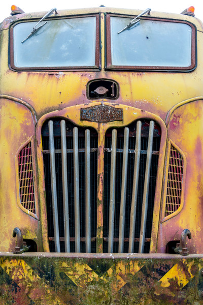 Front view of old classic fire truck in yellow and pink, art photograph