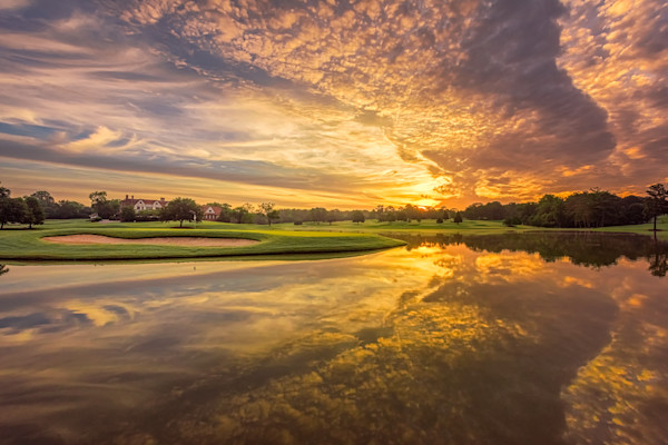 Dynamic dawn sky over East Lake's 15th Green