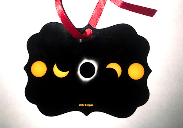 2017 Eclipse metal ornament with red ribbon