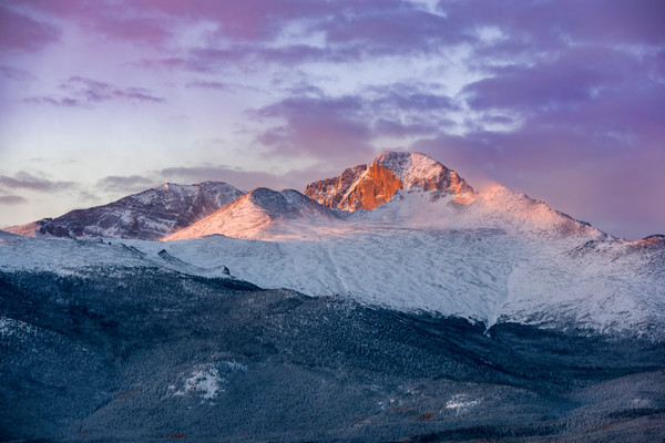 Photo of Snowy Longs Peak as Dawn's Purple light Illuminates Mountain and Clouds - RMNP