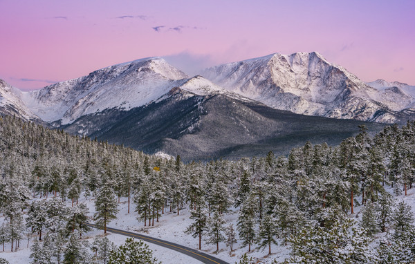 Photo of Snow Covered Ypsilon Mountain with Pink Hues from Belt of Venus