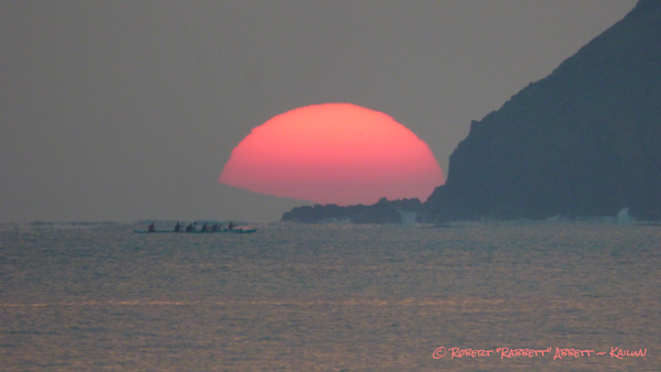 A Red Sun rises next to Moku Nui Islet in Amazing Kailua Bay! Images like this can only be seen in prints by Robert Abbett Art! Kailua! online right here