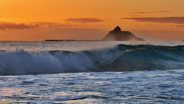 An orange sunrise with crashing waves on Kailua Bay! and I was there to capture it for you! Robert Abbett Art!