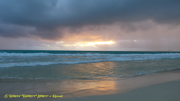 A stormy day on Kailua Bay with some pink and gold colors along the Horizon. Blessed Hawaiian Waters!