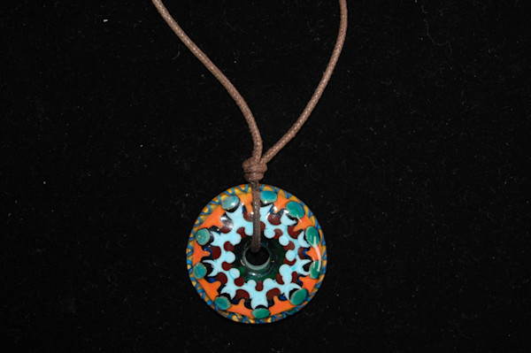 Fused Glass Mayan Disk Hand Crafted by Sage and Tom Holland.