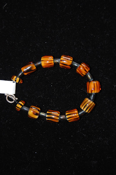 Orange and Black Fused Glass Bracelet Hand Crafted by Sage and Tom Holland.