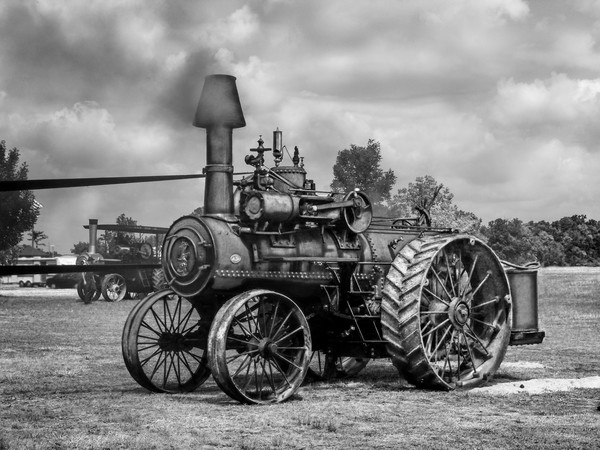 M Rumely Steam Powered Traction Engine In The Belt Blue Sky Black and White fleblanc