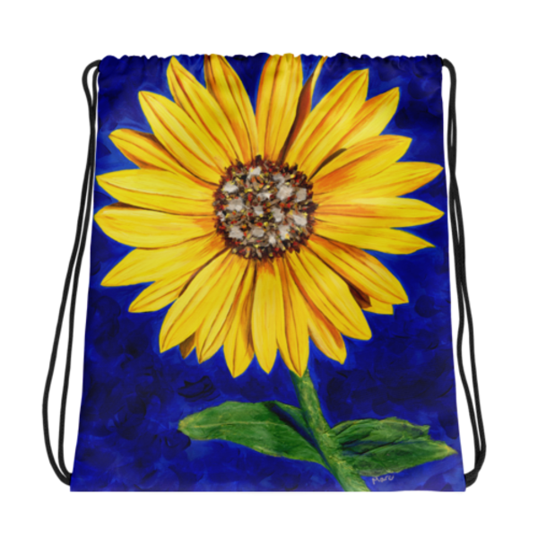 A strong yet delicate bright yellow sassy sunflower stands against a vibrant blue background. Drawstring Bags printed with Mare's Art artwork for a unique, stylish look.