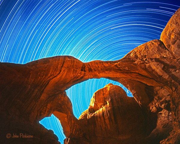 Double Arch in Arches National Park, Utah bathed in moonlight.