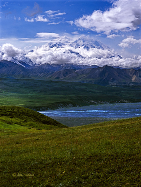 Denali is here bathed in the clouds of its own weather system